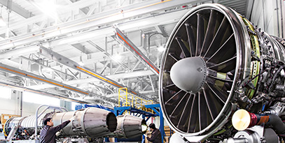 Hanwha Aerospace engineers perform quality control checks on engines.